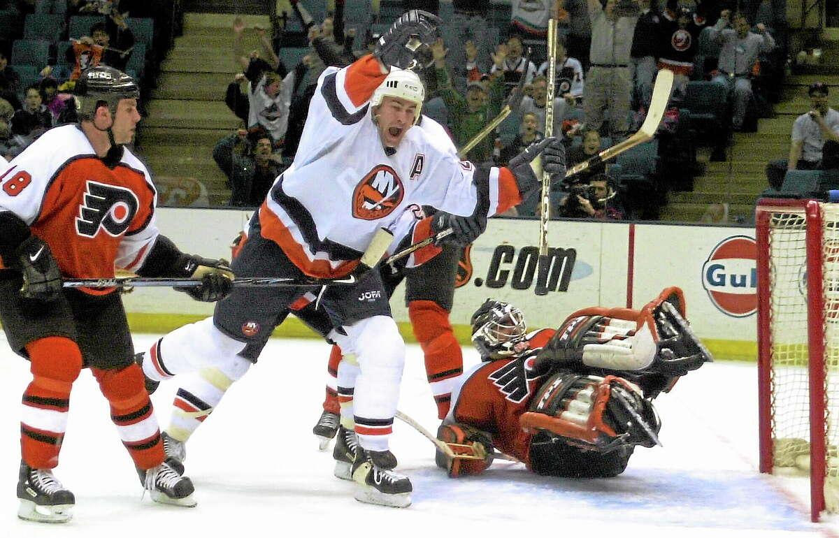The New York Islanders' Roman Hamrlik celebrates his game-winning goal on Feb. 22, 2001, in Uniondale, N.Y. Hamrlik, 39, retired on Monday.