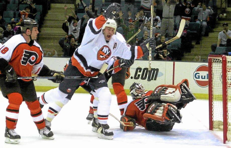 The New York Islanders' Roman Hamrlik celebrates his game-winning goal on Feb. 22, 2001, in Uniondale, N.Y. Hamrlik, 39, retired on Monday. Photo: Ron Frehm — The Associated Press  / AP