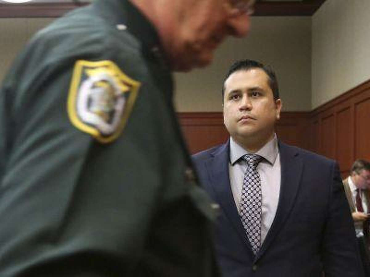 George Zimmerman stands as the judge leaves the courtroom as jury selection continues in his second-degree murder trial in Sanford, Florida, June 18, 2013. Zimmerman is accused of the fatal shooting of unarmed black teenager Trayvon Martin in February, 2012. (Joe Burbank/Pool/Reuters)