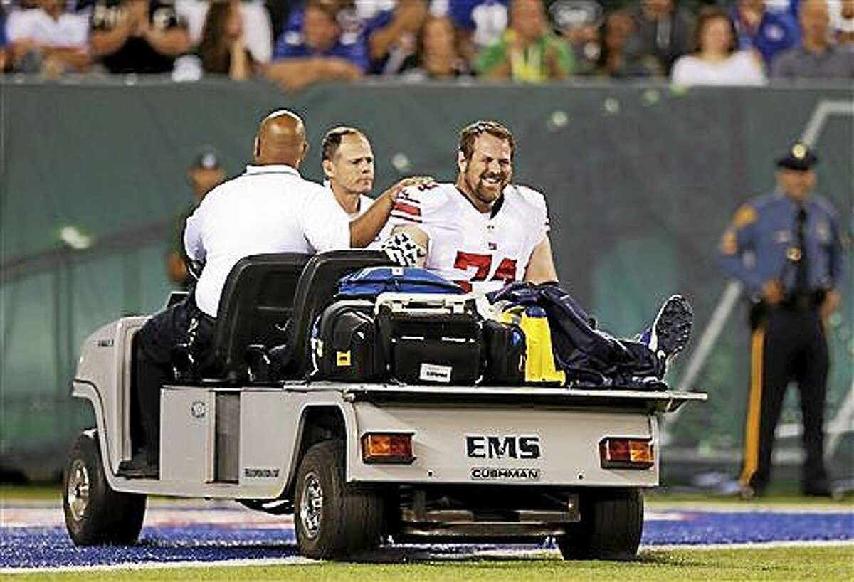 New York Giants guard Geoff Schwartz is carted off the field after an injury on Aug. 22.