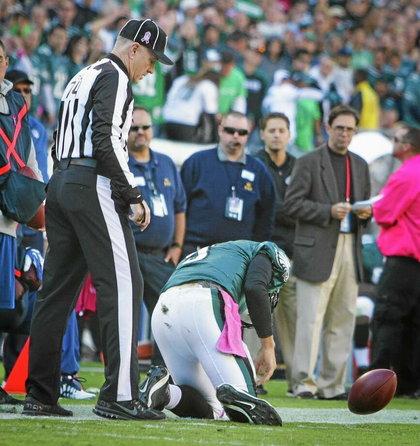 Eagles quarterback Nick Foles kneels near the end zone after being injured during Sunday's game against the Dallas Cowboys in Philadelphia. Photo: Suchat Pederson — The Wilmington News-Journal  / The News Journal