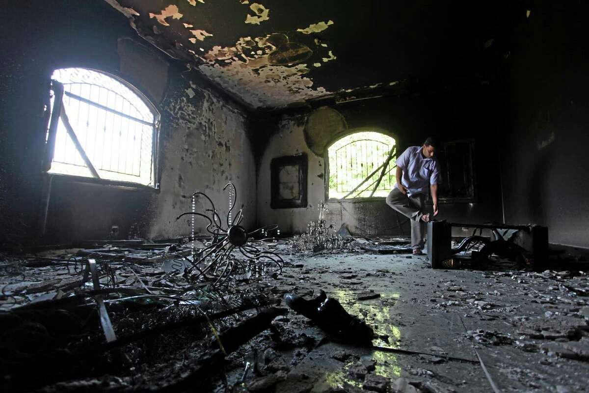 AP file photo This Sept 13, 2012, photo shows a Libyan man investigating the inside of the U.S. Consulate in Benghazi, Libya, after an attack that killed four Americans, including Ambassador Chris Stevens.