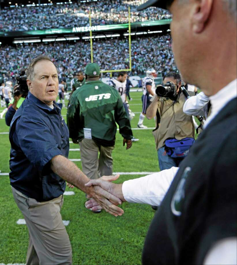 New England Patriots head coach Bill Belichick shakes hands with New York Jets head coach Rex Ryan after Sunday's game in East Rutherford, N.J. The Jets won the game 30-27. Photo: Seth Wenig — The Associated Press  / AP