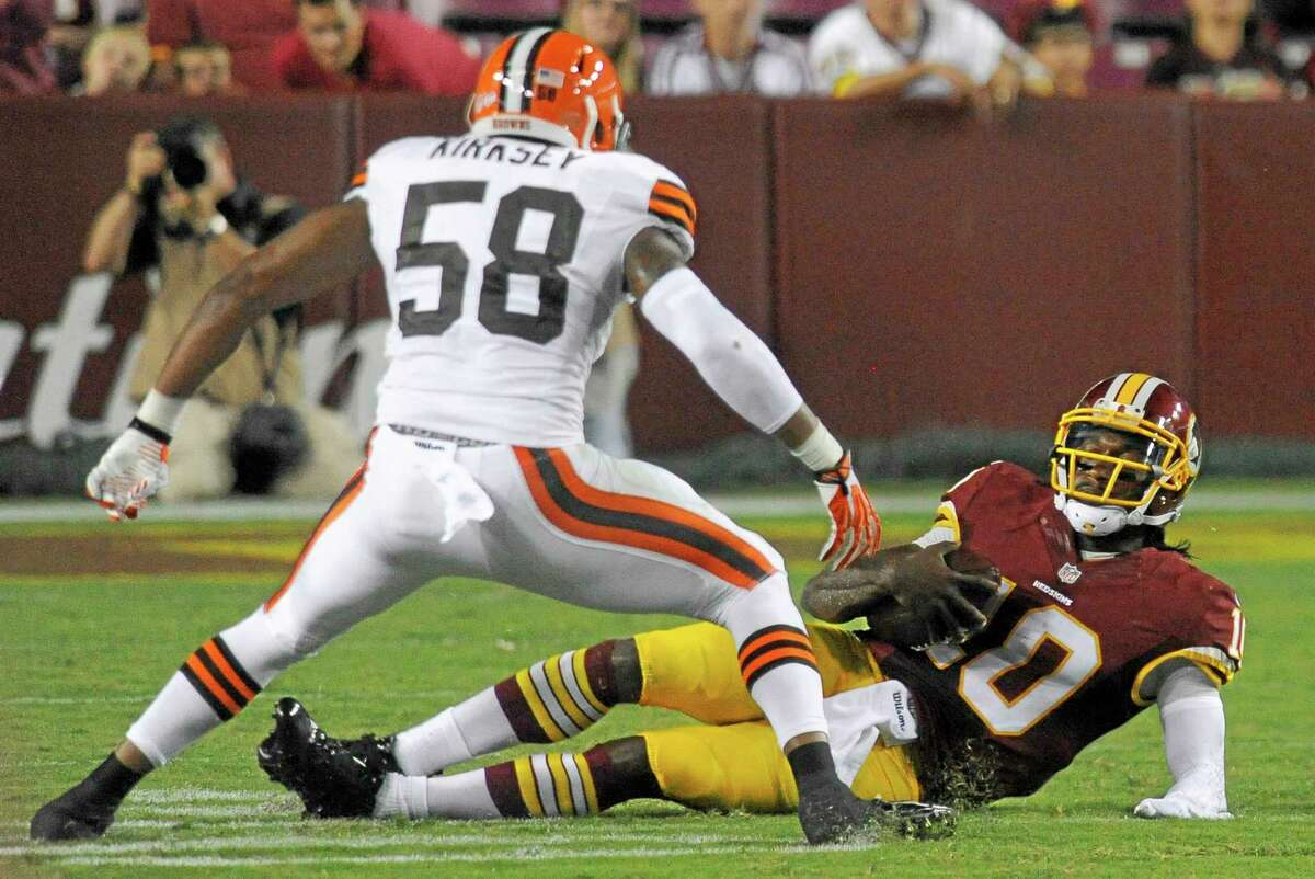 Washington Redskins quarterback Robert Griffin III slides down in front of Cleveland Browns linebacker Chris Kirksey (58) during an Aug. 18 preseason game in Landover, Md.