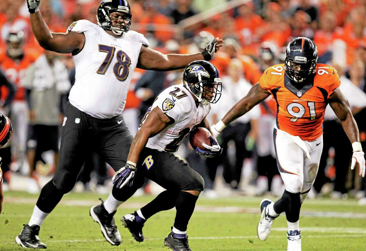 Baltimore Ravens running back Ray Rice (27) can't get into the end zone as teammate Bryant McKinnie (78) watches and Denver Broncos defensive end Robert Ayers pursues during their Sept. 5 game in Denver.