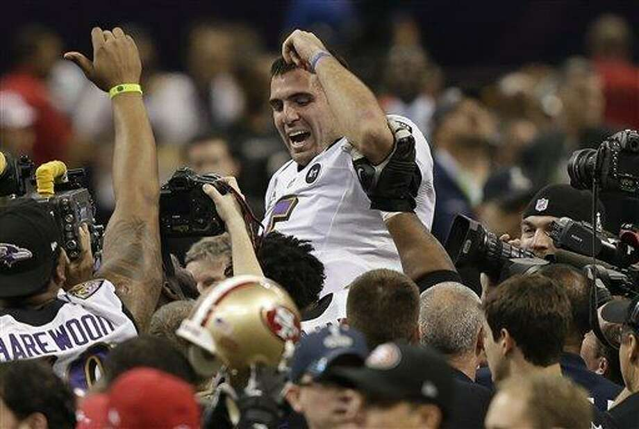 Baltimore Ravens quarterback Joe Flacco (5) is lifted into the air by teammates after defeating the San Francisco 49ers 34-31 in the NFL Super Bowl XLVII football game, Sunday, Feb. 3, 2013, in New Orleans. (AP Photo/Bill Haber) Photo: AP / 2013 AP