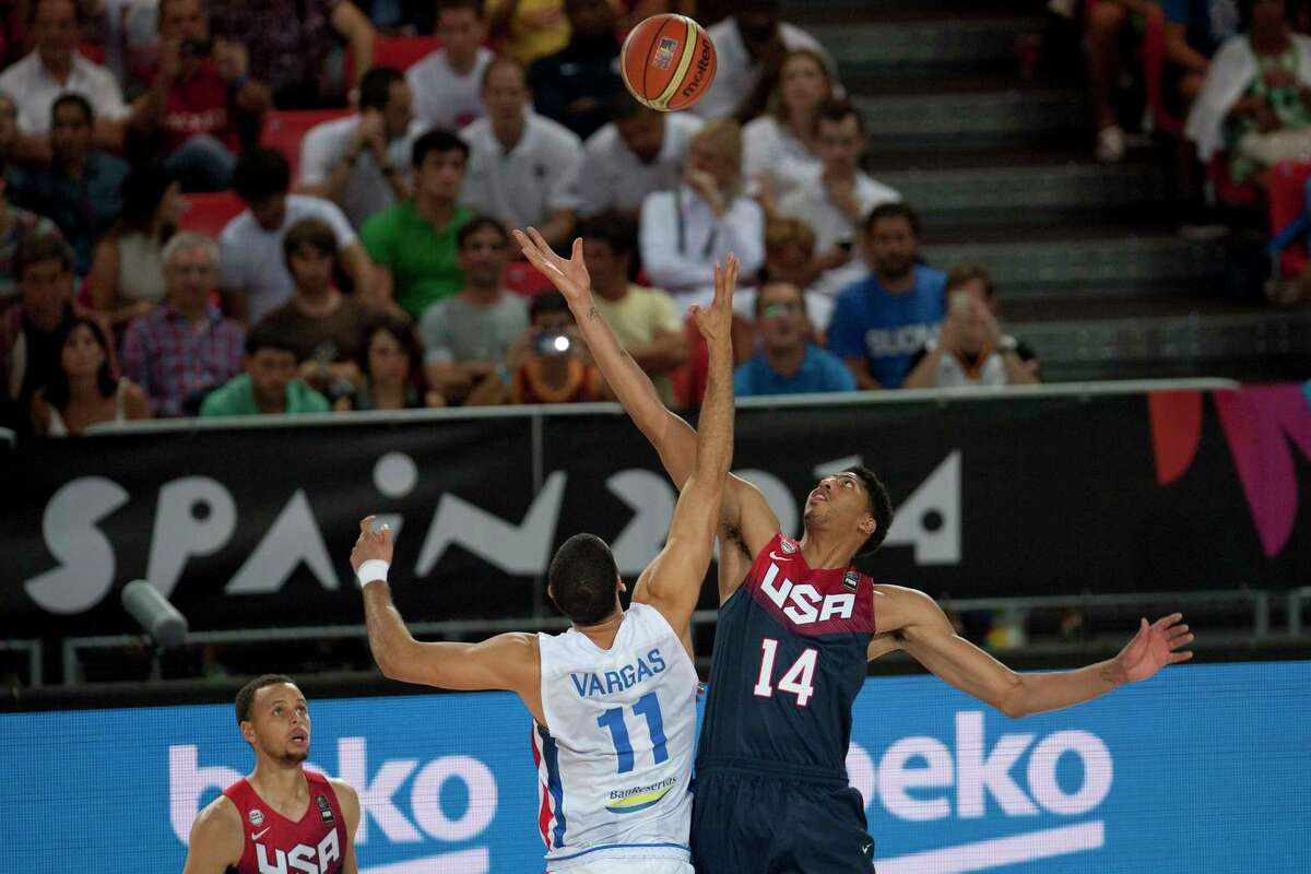 The United States' Anthony Davis, right, jumps for the ball with the Dominican Republic's Eloy Vargas during the Group C Basketball World Cup game on Wednesday in Bilbao, Spain.