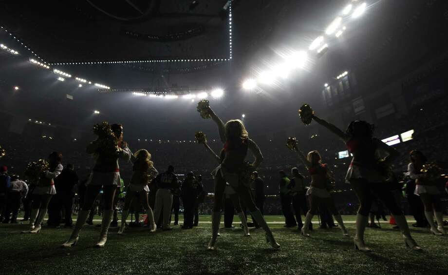 San Francisco 49ers cheerleaders perform during a power outage at the Superdome in the second half of the NFL Super Bowl XLVII football game between the 49ers and the Baltimore Ravens, Sunday, Feb. 3, 2013, in New Orleans. (AP Photo/Evan Vucci) Photo: AP / 2013 AP