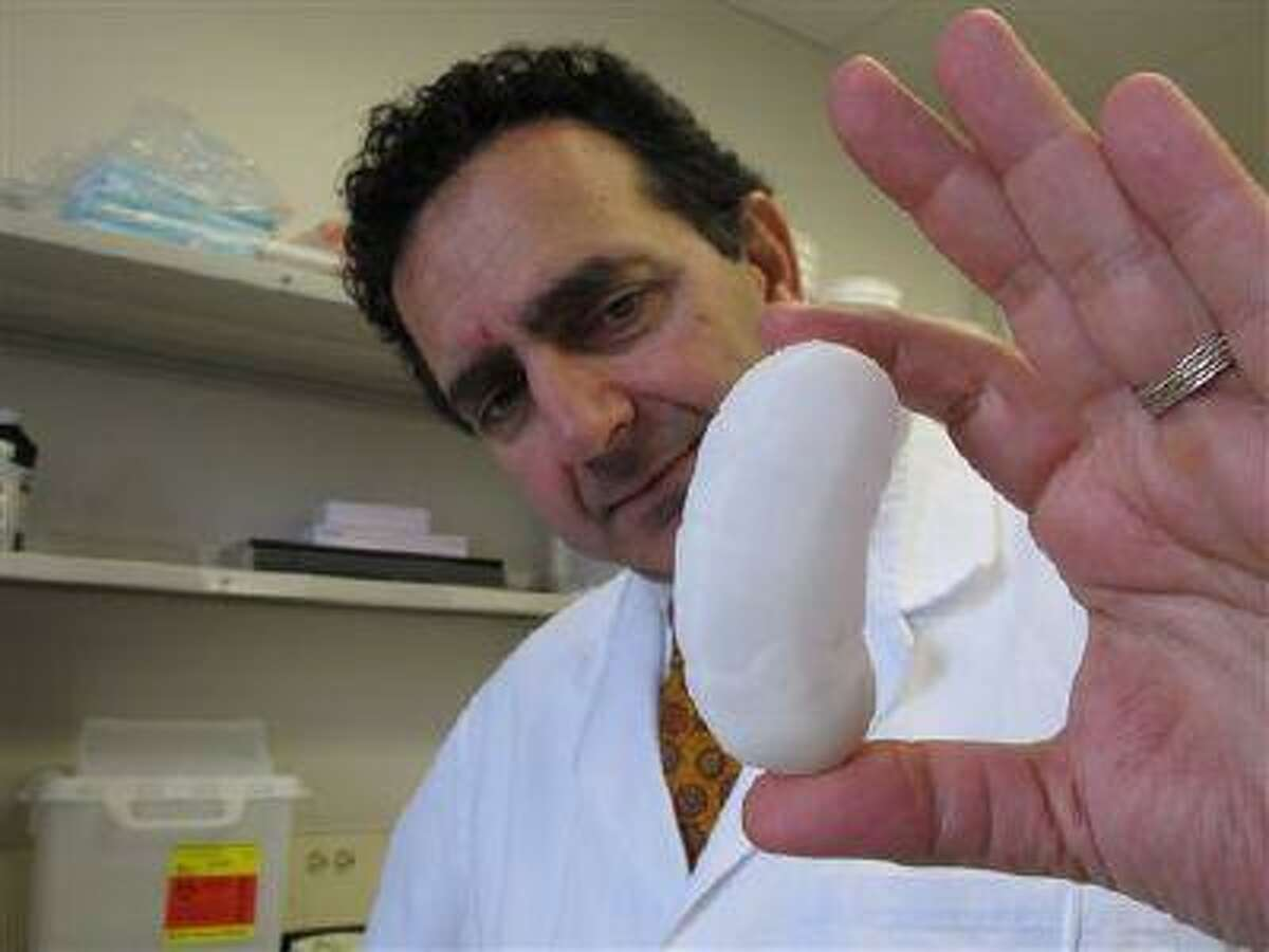Dr. Anthony Atala holds the