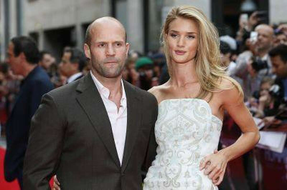 Actor Jason Statham arrives with his girlfriend Rosie Huntington-Whiteley for the world premiere of