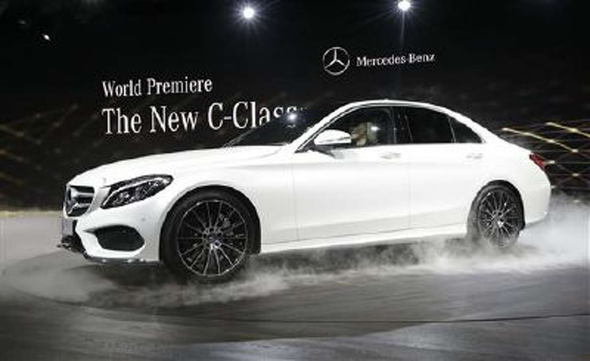Mercedes Benz unveils the new C-Class car during a preview night for the North American International Auto Show in Detroit, Sunday, Jan. 12, 2014.