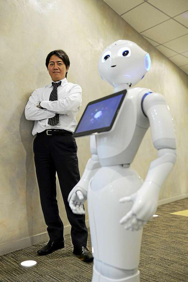 Billionaire Masayoshi Son will start selling his humanoid robots named ìPepperî at Sprint stores in the U.S. by next summer, part of SoftBankís push to take the technology beyond factory floors. Photo: Bloomberg News Photo By Akio Kon  / © 2014 Bloomberg Finance LP