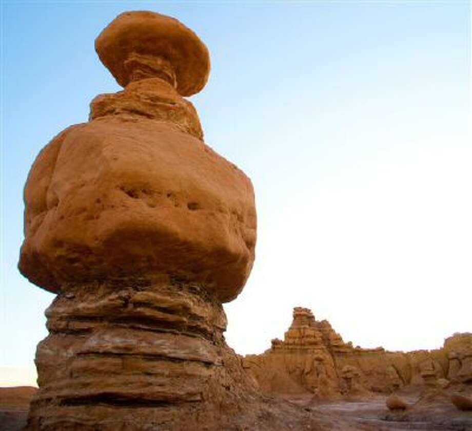 This undated photo released by Utah State Parks shows a rock formation at Goblin Valley State Park. Authorities say three men could face felony charges after purposely knocking over an ancient Utah desert rock formation and posting a video of the incident online. State parks spokesman Eugene Swalberg says the formation at Goblin Valley State Park is about 170 million years old. The park is dotted with thousands of the eerie, mushroom shaped sandstone formations. (AP Photo/Utah State Parks) Photo: AP / Utah State Parks