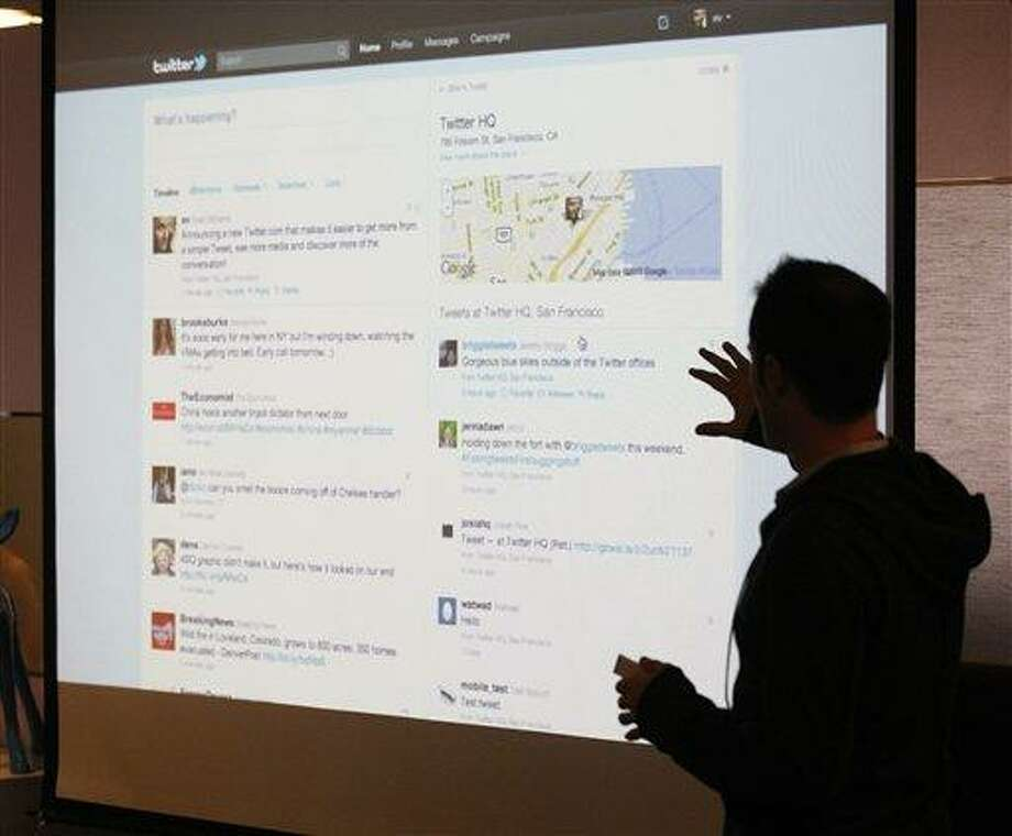 FILE - In this Sept. 14, 2010 file photo, Twitter CEO Evan Williams makes a presentation about changes to the social network at Twitter headquarters in San Francisco,  In the latest online attack, Twitter says hackers may have gained access to information on 250,000 of its more than 200 million active users, Friday, Feb. 1, 2013. (AP Photo/Marcio Jose Sanchez, File) Photo: AP / AP