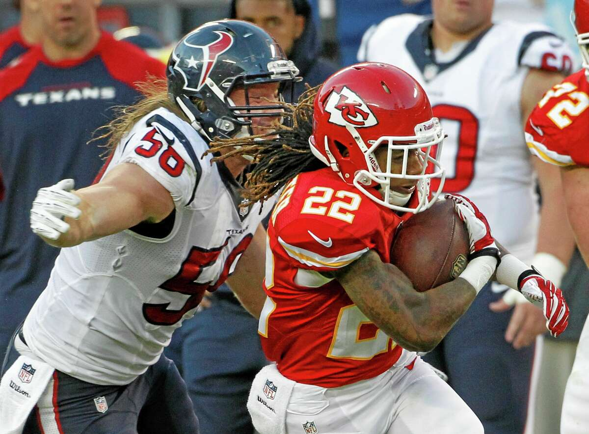 Kansas City Chiefs wide receiver Dexter McCluster is tackled by Houston Texans inside linebacker Brian Cushing (56) during the second half of Sunday's game in Kansas City, Mo.