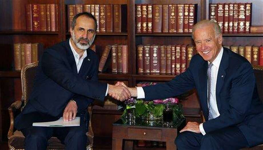 US Vice President Joe Biden, right, and Sheikh Moaz al-Khatib, Syria's  top opposition leader, shake hands at the Security Conference in Munich, southern Germany, on Saturday, Feb. 2, 2013.  (AP Photo/Matthias Schrader) Photo: AP / AP