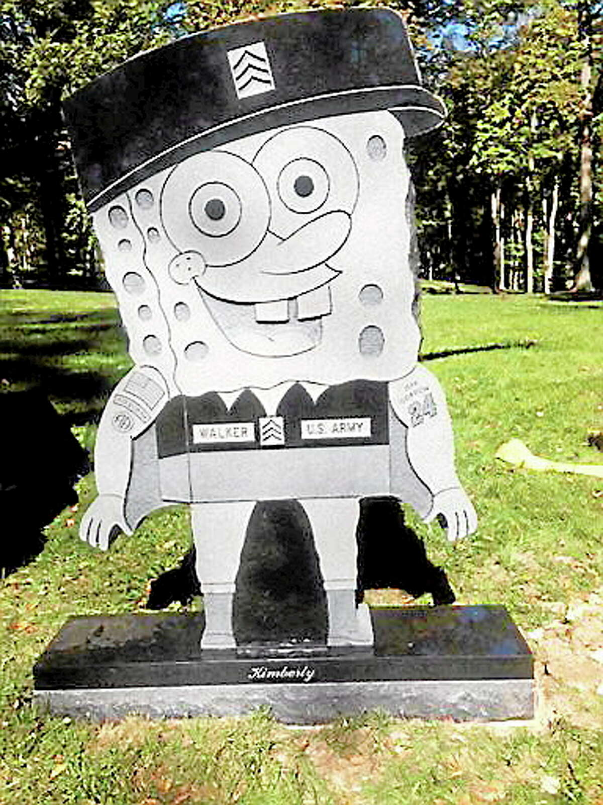 In this Thursday, Oct. 10, 2013, photo provided by the family of Kimberly Walker, shows Walker's gravestone in the likeness of popular cartoon character SpongeBob SquarePants. Despite getting prior approval for the gravestone from Spring Grove Cemetery in Cincinnati, the cemetery recently removed it, saying it did not fit in with the character of the historic and picturesque cemetery. (AP Photo/Kara Walker)