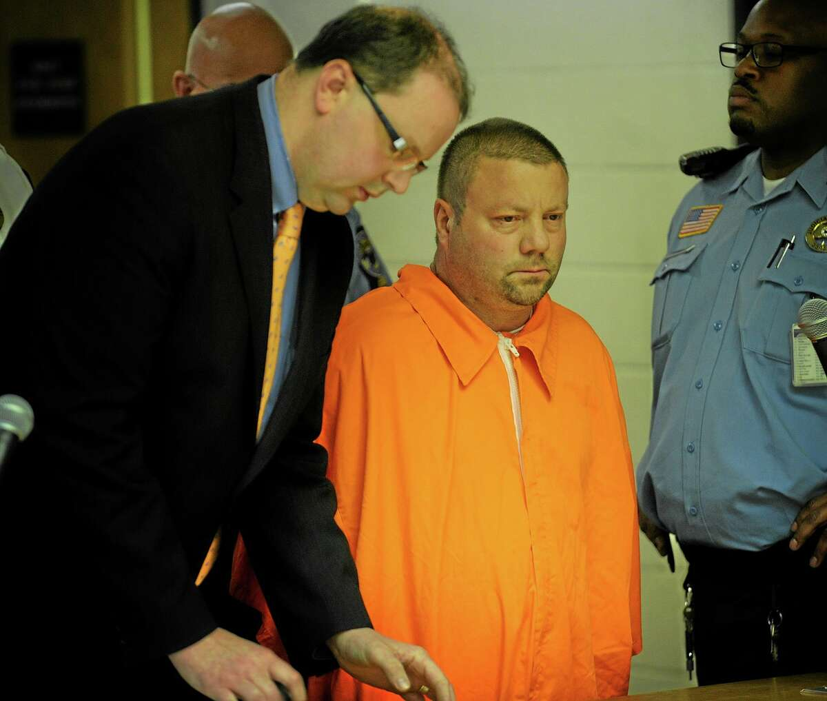 Scott Gellatly, right, stands before the judge during his arraignment in Superior court in Derby on Thursday, May 8, 2014.