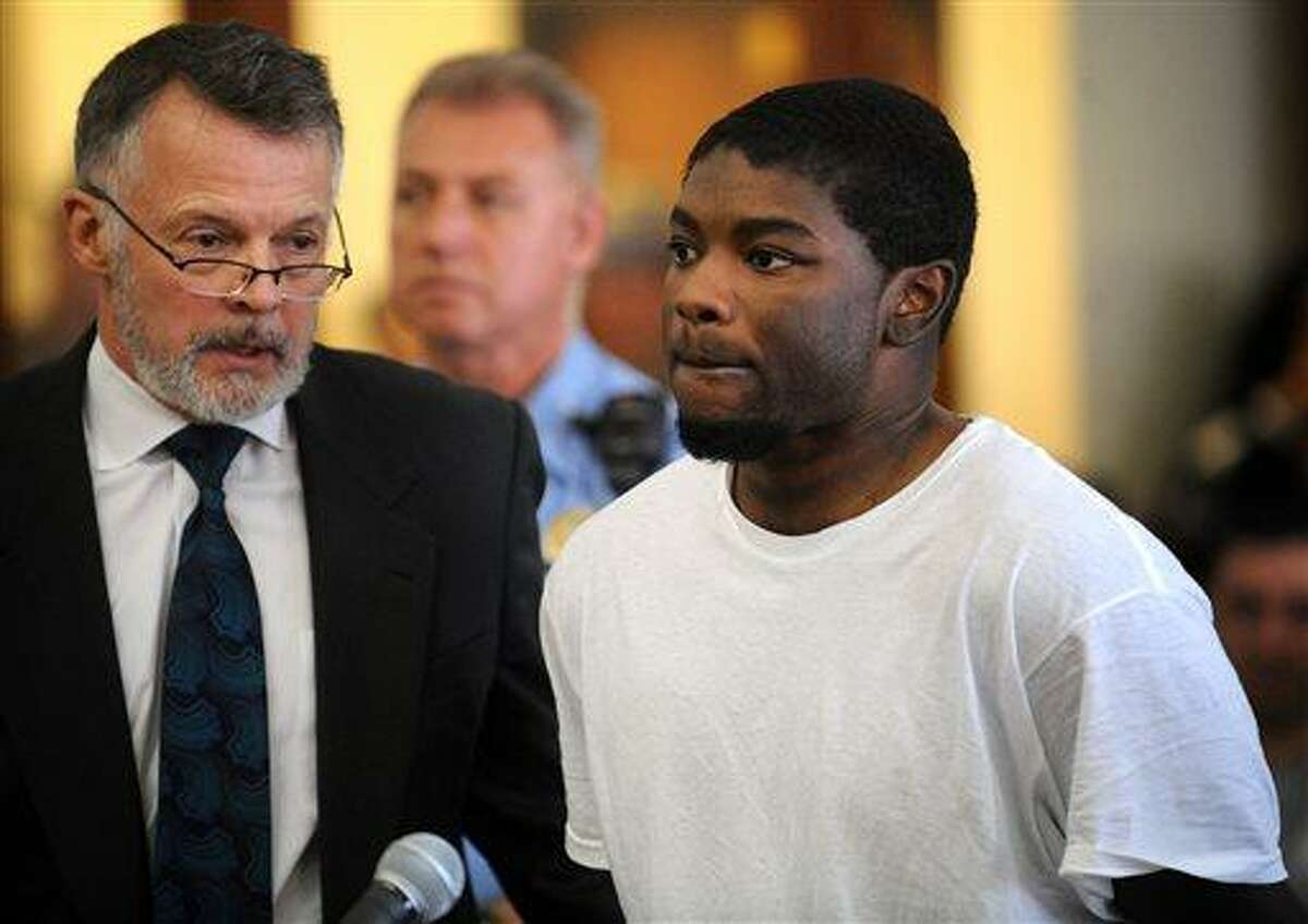 Jermaine Richards, right, standing with his lawyer, John R. Gulash, is arraigned on murder and kidnapping charges in the death of Eastern Connecticut State University (ECSU) student Alyssiah Marie Wiley at Superior Court in Bridgeport, Conn. on Monday, May 20, 2013. Richards, 31, is accused of killing his girlfriend Wiley, 20, who disappeared April 20 near the Willimantic campus and was found dead Friday, May 17 in a wooded area of Trumbull. She was a sophomore psychology major. (AP Photo/Connecticut Post, Brian A. Pounds, Pool)