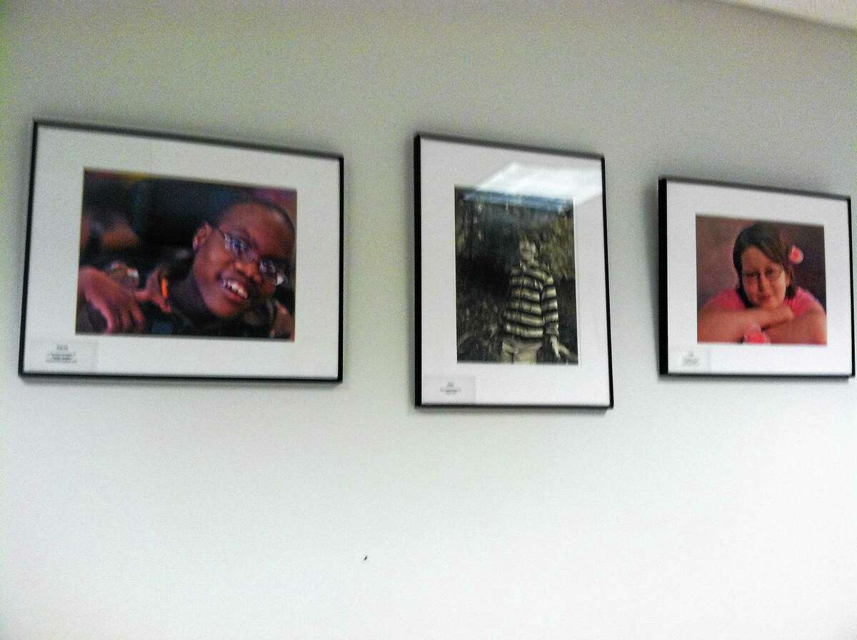 Some of the photos featured in the Heart Gallery of America display at Charlotte Hungerford Hospital.