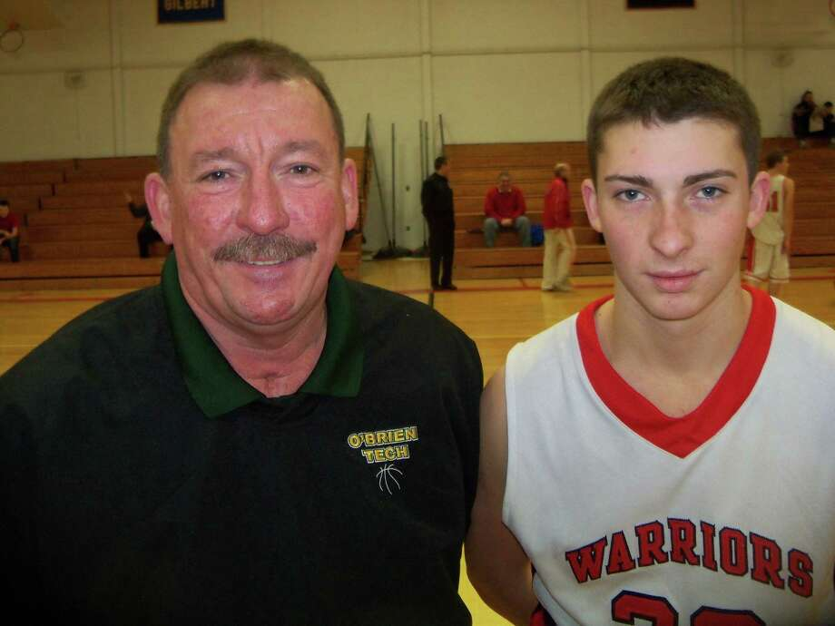 O'Brien Tech head coach Dan Nemergut stands with his son, Wamogo's Nick Nemergut before the two squared off Saturday. Photo by Peter Wallace/Register Citizen
