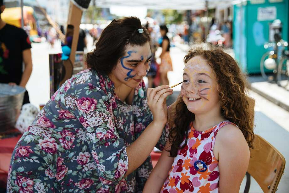 Pink Granell face paints Anna Purcell Duff, 9, during the 826 Day block party in San Francisco, Calif. Saturday, August 26, 2017. Photo: Mason Trinca, Special To The Chronicle