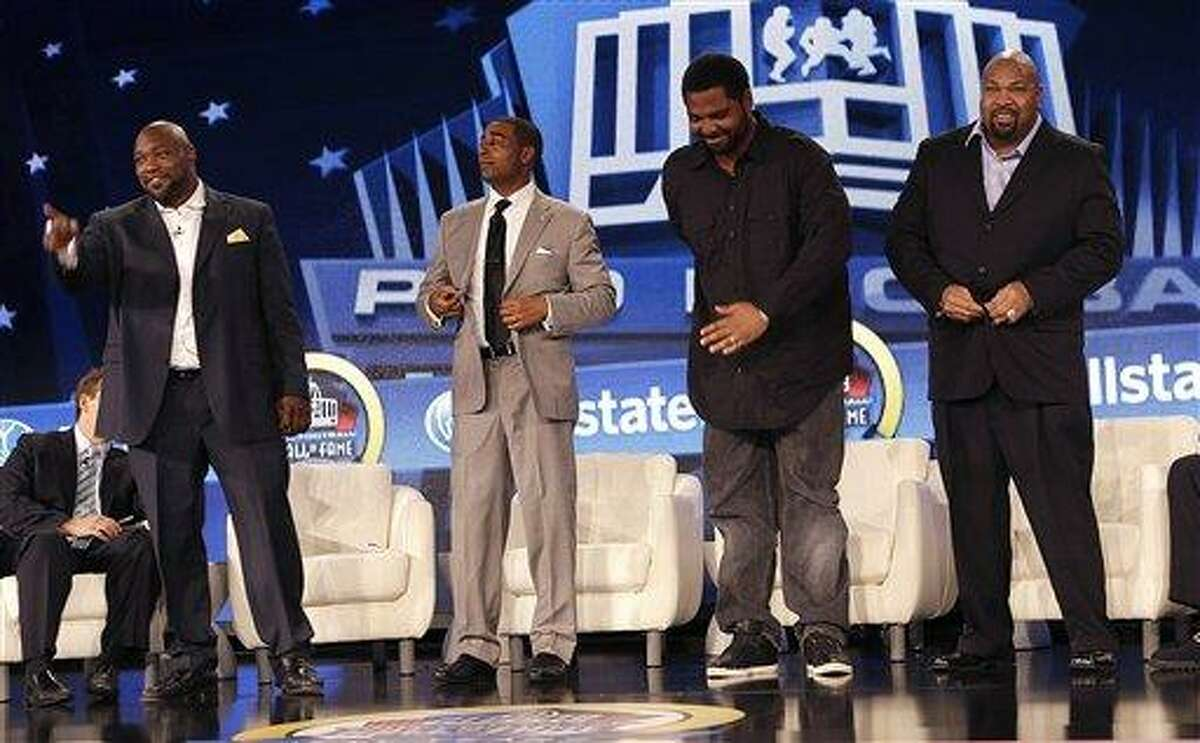 From left, former Tampa Bay Buccaneers tackle Warren Sapp, former Minnesota Vikings wide receiver Cris Carter, former Baltimore offensive lineman Jonathan Ogden, and Former Dallas Cowboy offensive lineman Larry Allen stand after they were selected to the Pro Football Hall of Fame on Saturday, Feb. 2, 2013, in New Orleans. (AP Photo/Gerald Herbert)