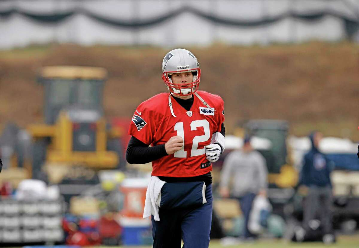 New England Patriots quarterback Tom Brady practices Thursday at the team facility in Foxborough, Mass. The Patriots will play the Denver Broncos in the AFC championship game on Sunday in Denver.