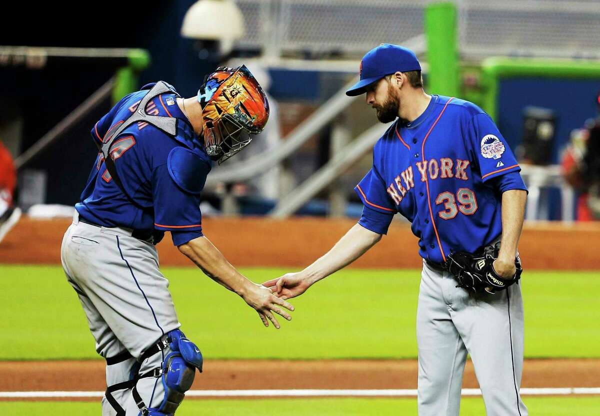 New York Mets closer Bobby Parnell, right, feels he will be the closer again when the 2014 season opens after recovering from surgery to repair a herniated disk in his neck.