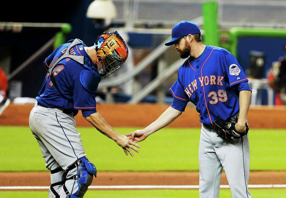 New York Mets closer Bobby Parnell, right, feels he will be the closer again when the 2014 season opens after recovering from surgery to repair a herniated disk in his neck. Photo: Lynne Sladky — The Associated Press  / AP2013