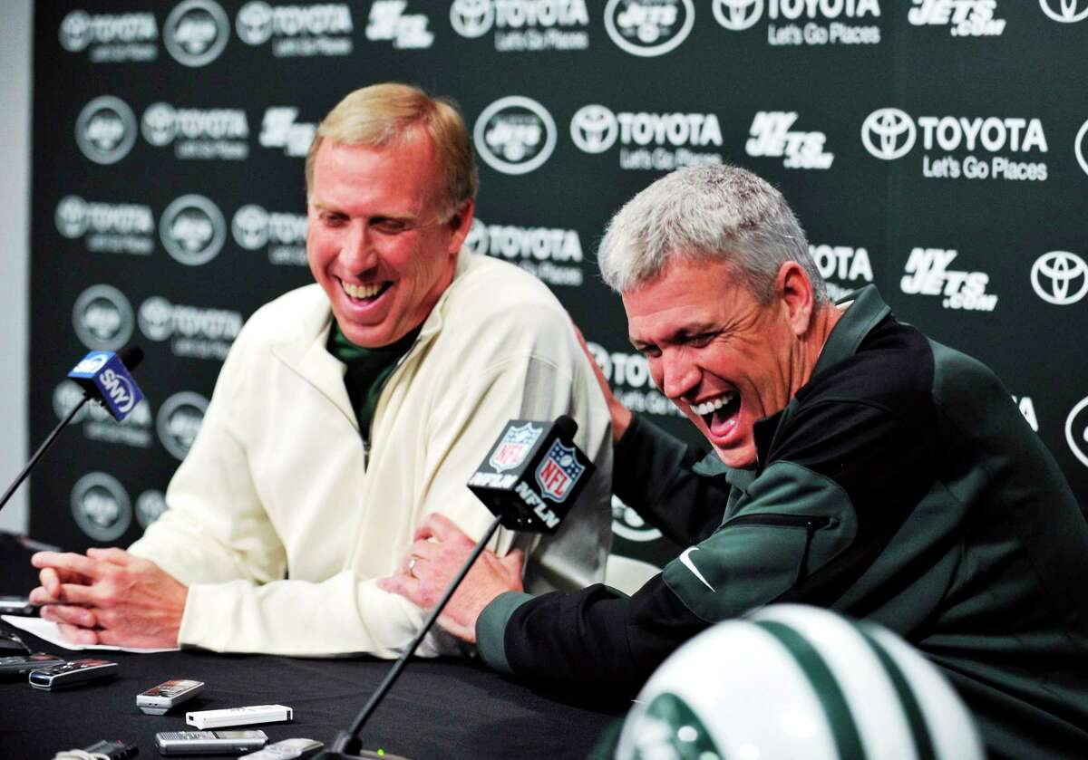 New York Jets coach Rex Ryan, right, and general manager John Idzik speak to the media on Dec. 31 in Florham Park, N.J. On Thursday, the Jets signed Ryan to a contract extension.