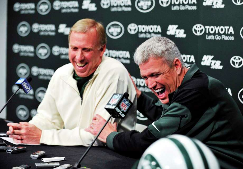 New York Jets coach Rex Ryan, right, and general manager John Idzik speak to the media on Dec. 31 in Florham Park, N.J. On Thursday, the Jets signed Ryan to a contract extension. Photo: Bill Kostroun — The Associated Press  / AP2013