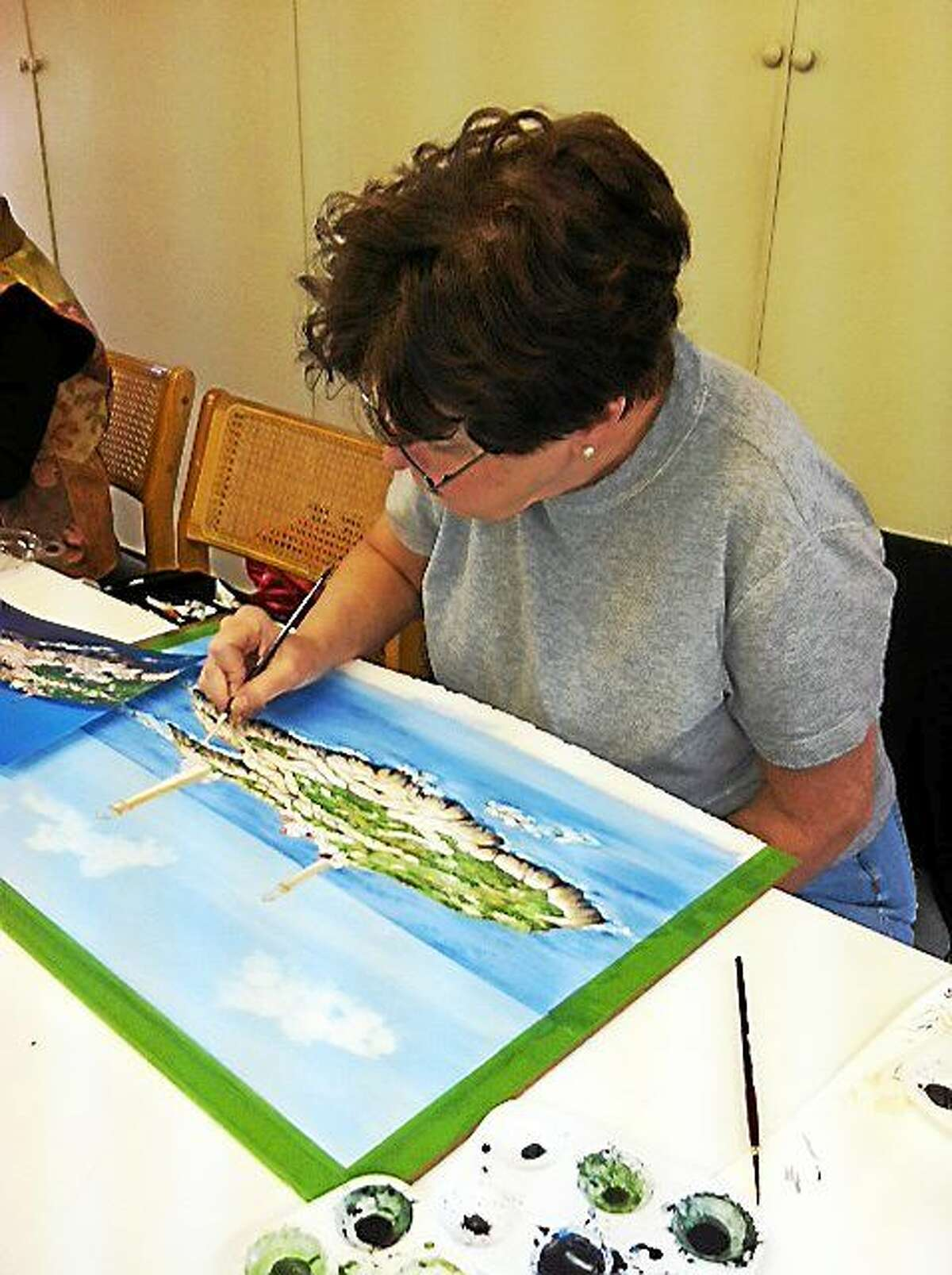 Contributed photo Artist Ginny Erickson works at her Lily Hill Studio.
