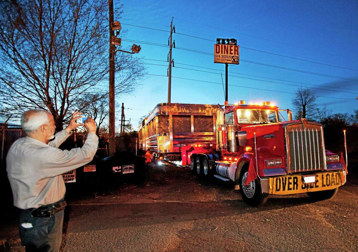 """Mohamed """"Moe"""" Ali takes a farewell picture of the former Forbes Diner on May 7 before it is moved to a new home in Salisbury."""