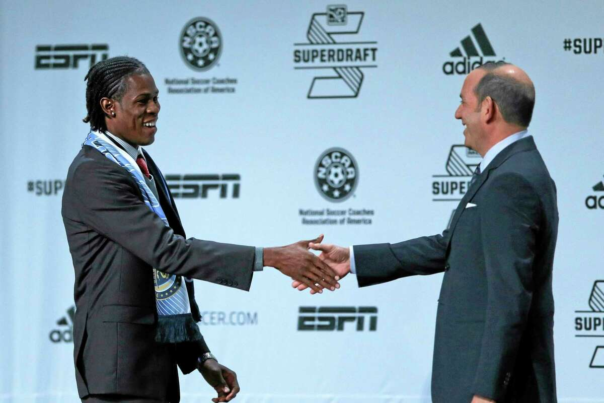 Andre Blake, left, shakes hands with MLS Soccer Commissioner Don Garber after being selected by the Philadelphia Union at the Major League Soccer SuperDraft on Thursday in Philadelphia.