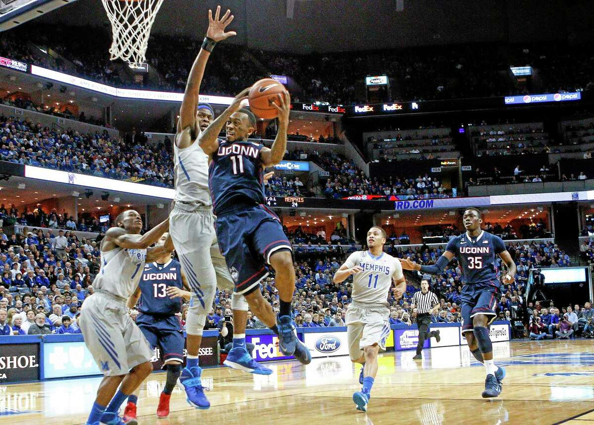 UConn guard Ryan Boatright goes to the basket against in the first half of Thursday's game against Memphis.