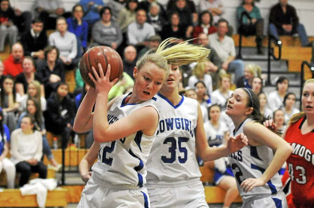 Litchfield's Shelby Elwell grabs a rebound in the Cowgirls 49-33 win over Wamogo.