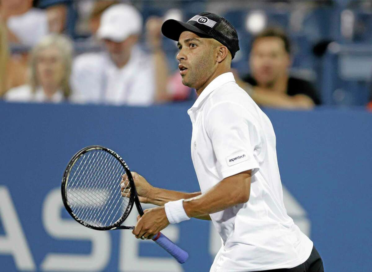 In this Aug. 28, 2013 file photo, James Blake competes against Ivo Karlovic at the U.S. Open in New York. Officials say firefighters have found three bodies in a burning mansion owned by a Blake in Tampa, Florida.