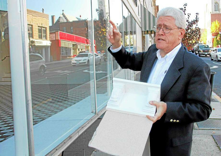 Steven Roth of the Torrington Downtown Partners holds an example piece of cornice that will adorn some of the six buildings that will be renovated during a press conference on Monday, Oct. 21, in downtown Torrington.  The plan is to renovate the facade of six of the partner's nine buildings with the help of a state grant. Photo: Esteban L. Hernandez—Register Citizen