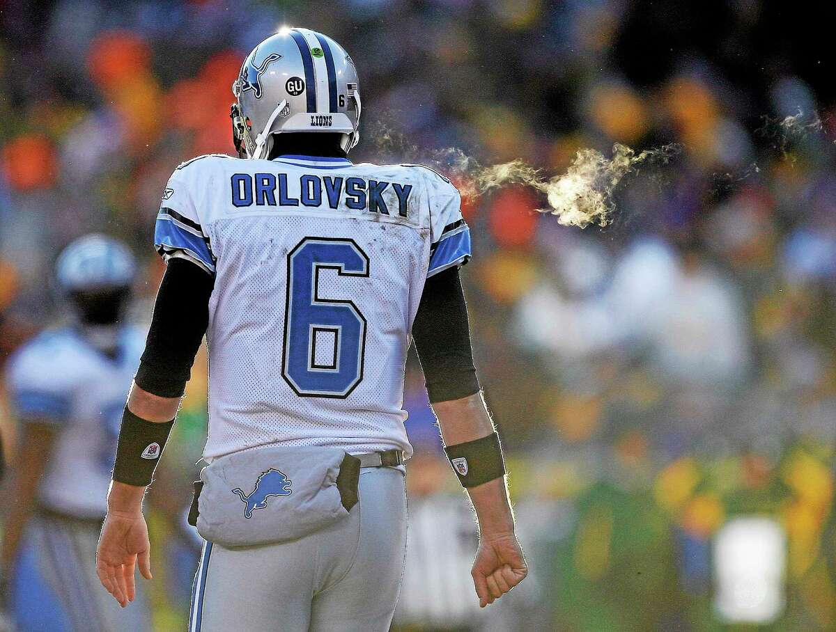 Detroit Lions quarterback Dan Orlovsky, who grew up in Shelton and attended UConn, walks off Lambeau Field during the second half of a game against the Packers on Dec. 28, 2008, in Green Bay, Wisconsin.