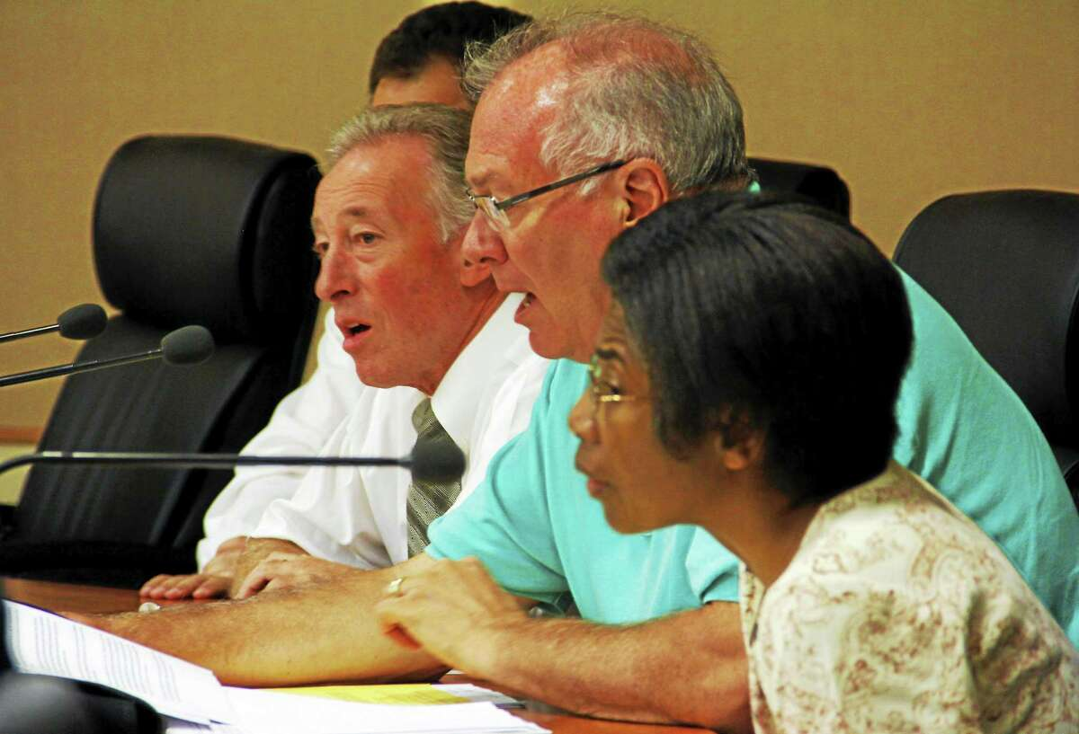 From left: Torrington Board of Safety commissioners Robert F. Conforti, Jr., Glenn McLeod and Darlene Battle during a board meeting Wednesday in Torrington.