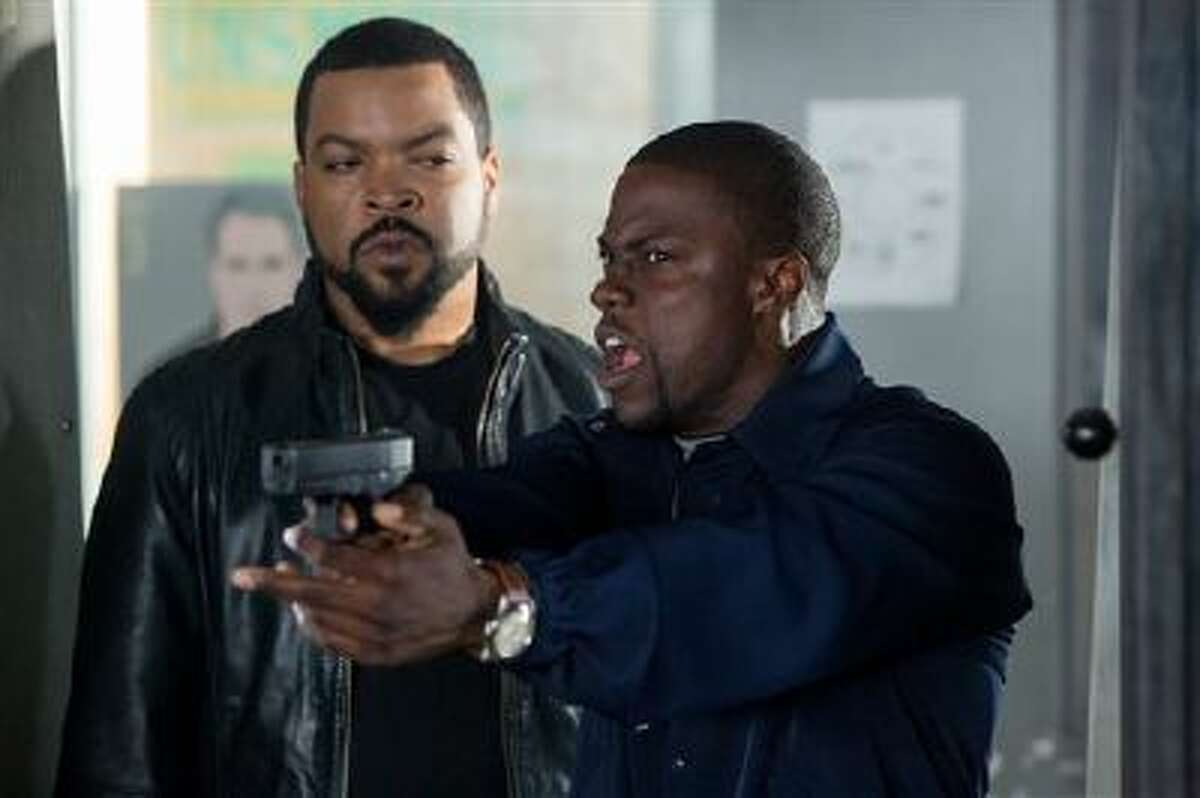 This image released by Universal Pictures shows Ice Cube, left, and Kevin Hart in a scene from