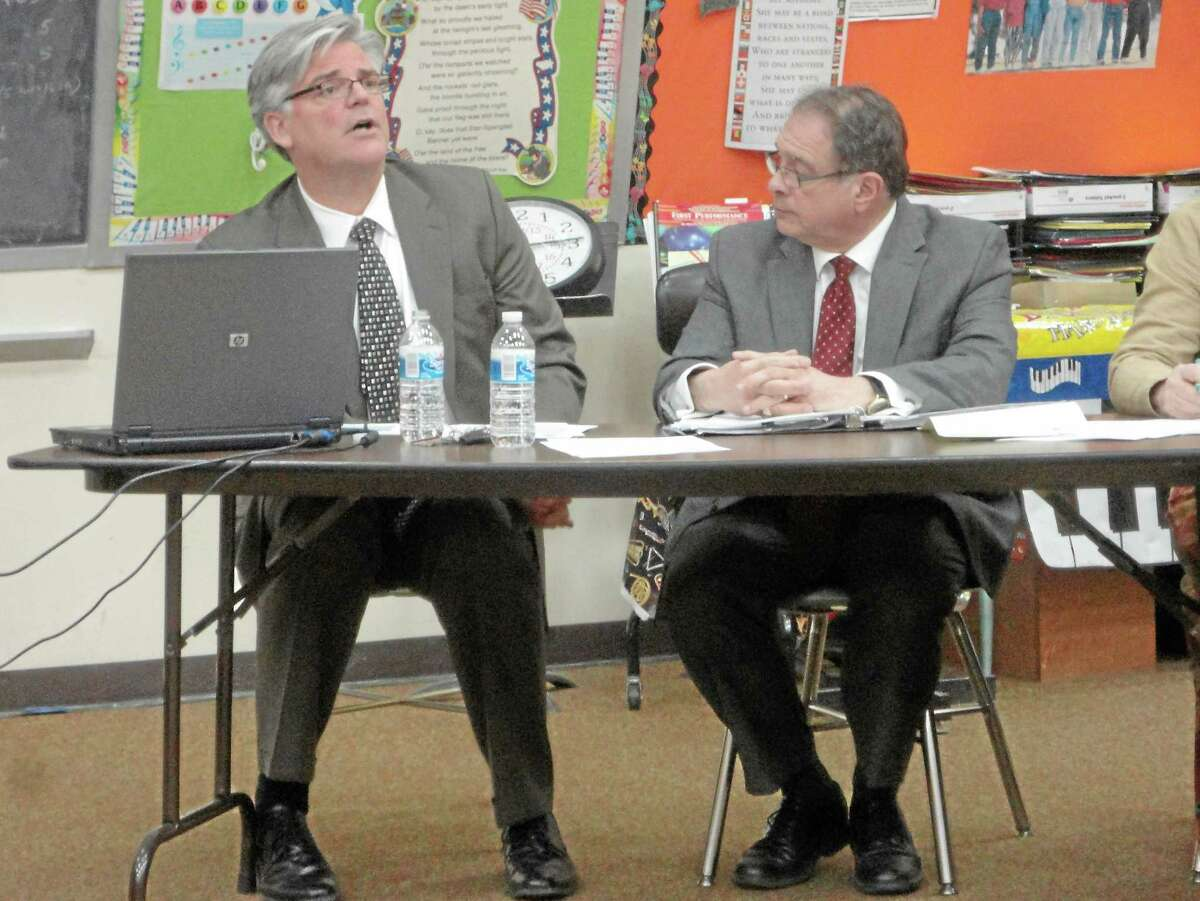 Winchester Superintendent of Schools Thomas Danehy, left, and Gilbert School Superintendent Anthony Serio run down their proposed budgets in a special joint meeting between the Board of Education and Board of Selectmen earlier this year.