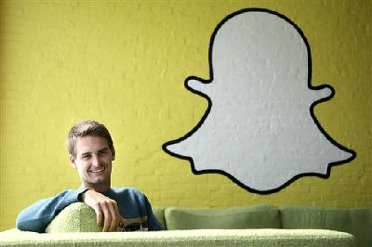 In this Thursday, Oct. 24, 2013, Snapchat CEO Evan Spiegel poses for photos, in Los Angeles. Spiegel dropped out of Stanford University in 2012, three classes shy of graduation, to move back to his father's house and work on Snapchat. Spiegel?s fast-growing mobile app lets users send photos, videos and messages that disappear a few seconds after they are received (AP Photo/Jae C. Hong)