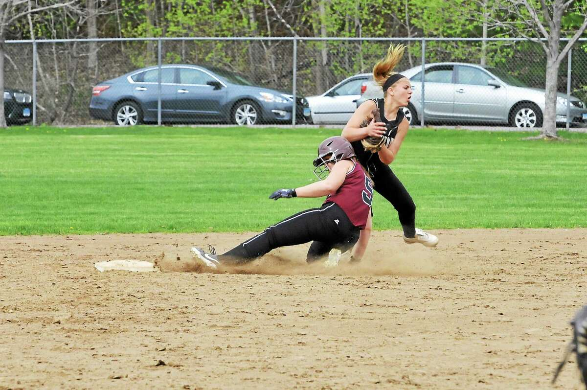 Torrington's Alexa Potter slides into second base trying to break up a double play, as Woodland's Cameron Caswell tries to get out of the way.