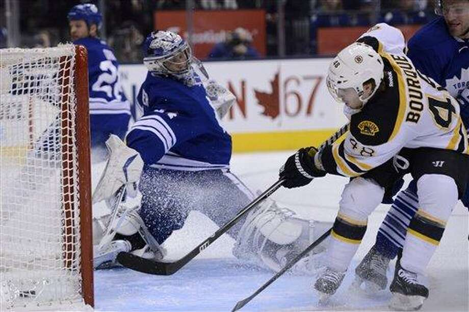 Boston Bruins left wing Chris Bourque scores on Toronto Maple Leafs goalie James Reimer during the first period of an NHL hockey game in Toronto on Saturday, Feb. 2, 2013. (AP Photo/The Canadian Press, Frank Gunn) Photo: ASSOCIATED PRESS / AP2013