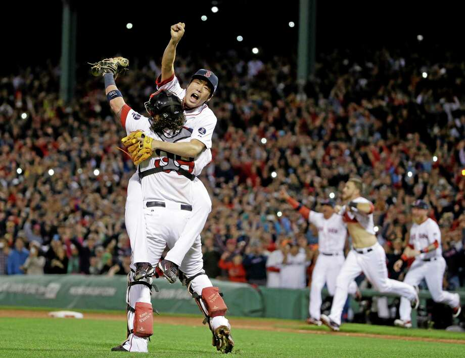 Red Sox relief pitcher Koji Uehara, rear, and catcher Jarrod Saltalamacchia celebrate Boston's 5-2 win over the Detroit Tigers in Game 6 of the ALCS on Saturday. Photo: Matt Slocum — The Associated Press  / AP