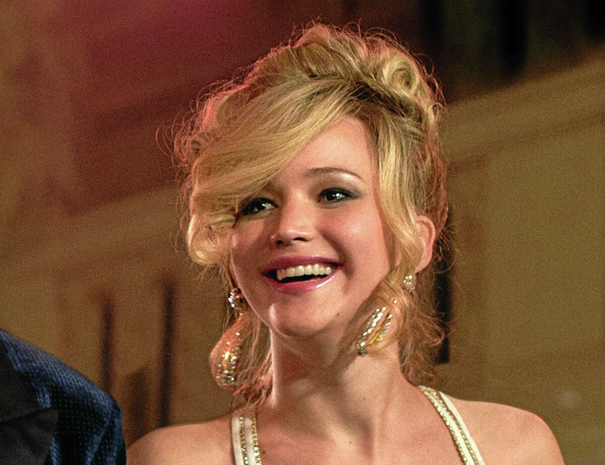 """This film image released by Sony Pictures shows Jennifer Lawrence in a scene from """"American Hustle."""" Lawrence was nominated for an Academy Award for best supporting actress on Thursday, Jan. 16, 2014, for her role in the film. The 86th Academy Awards will be held on March 2. (AP Photo/Sony - Columbia Pictures, Francois Duhamel)"""