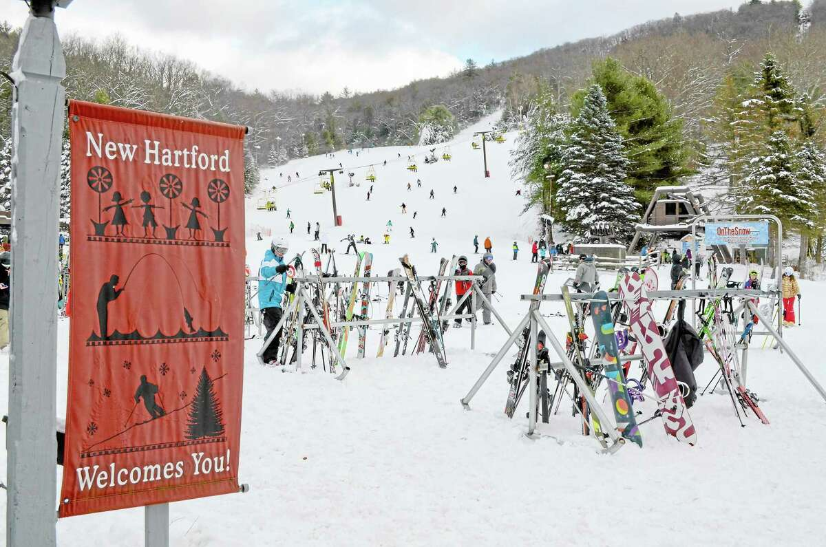 Skiers and snowboarders at Ski Sundown during opening weekend 2013.
