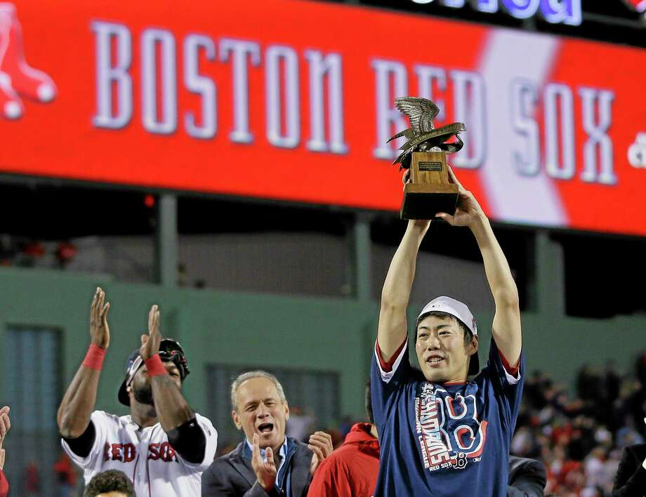 Red Sox closer Koji Uehara hoists the ALCS most valuable player trophy after the Red Sox beat the Detroit Tigers 5-2 in Game 6 on Saturday. Photo: Matt Slocum — The Associated Press  / AP
